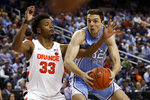 Syracuse forward Elijah Hughes (33) guards North Carolina guard Justin Pierce (32) during the first half of an NCAA college basketball game at the Atlantic Coast Conference tournament in Greensboro, N.C., Wednesday, March 11, 2020. (AP Photo/Ben McKeown)