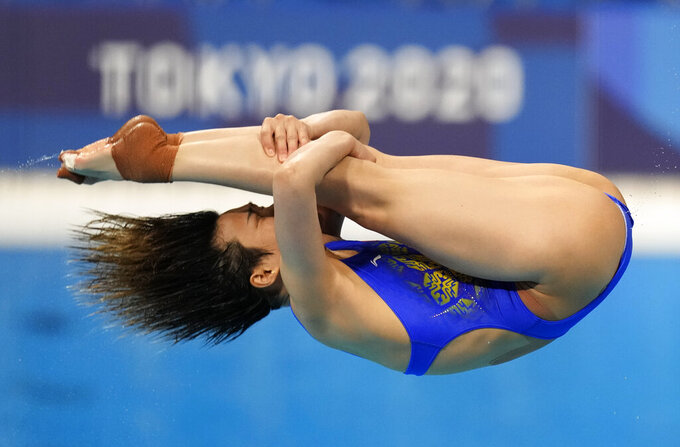 Shi Tingmao of China competes in women's diving 3m springboard semifinal at the Tokyo Aquatics Centre at the 2020 Summer Olympics, Saturday, July 31, 2021, in Tokyo, Japan. (AP Photo/Dmitri Lovetsky)