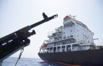 Sailors stand on deck above a hole the U.S. Navy says was made by a limpet mine on  the damaged Panama-flagged, Japanese owned oil tanker Kokuka Courageous, anchored off Fujairah, United Arab Emirates, during a trip organized by the Navy for journalists, Wednesday, June 19, 2019. The limpet mines used to attack the oil tanker near the Strait of Hormuz bore
