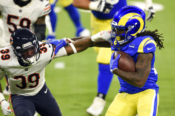 Los Angeles Rams running back Darrell Henderson, right, tries to get around Chicago Bears defensive back Eddie Jackson (39) during the second half of an NFL football game Monday, Oct. 26, 2020, in Inglewood, Calif. (AP Photo/Kelvin Kuo)