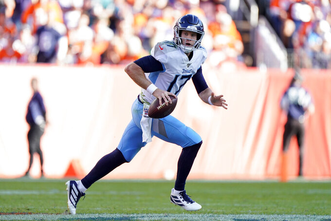 Tennessee Titans quarterback Ryan Tannehill scrambles during the second half of an NFL football game against the Denver Broncos, Sunday, Oct. 13, 2019, in Denver. (AP Photo/Jack Dempsey)