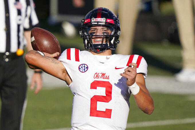 Mississippi quarterback Matt Corral passes against Vanderbilt in the first half of an NCAA college football game Saturday, Oct. 31, 2020, in Nashville, Tenn. (AP Photo/Mark Humphrey)