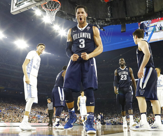 FILE - In this Monday, April 4, 2016, file photo, Villanova guard Josh Hart (3) reacts to play against North Carolina during the second half of the NCAA Final Four tournament college basketball championship game in Houston. The NCAA and networks across the sports dial have infused fans with a hoops fix by rebroadcasting epic NCAA Tournament games. Coaches and players involved in those games are adding insight and a dash of humor by live tweeting during the replay. (AP Photo/David J. Phillip, File)