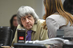 David Turpin listens to his attorney, Allison Lowe, during a sentencing hearing Friday, April 19, 2019, in Riverside, Calif. Turpin and his wife, Louise, who pleaded guilty to years of torture and abuse of 12 of their 13 children have been sentenced to life in prison with possibility of parole after 25 years. (Will Lester/The Orange County Register via AP, Pool)