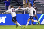 Virginia's Joe Bell (8) celebrates with Robin Afamefuna (30) after scoring a goal during the first half of the NCAA college soccer championship against Georgetown in Cary, N.C., Sunday, Dec. 15, 2019. (AP Photo/Ben McKeown)