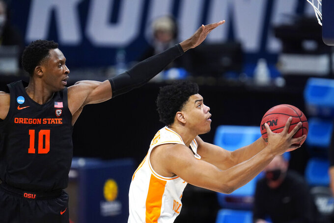 Tennessee guard Jaden Springer, right, drives on Oregon State forward Warith Alatishe (10) during the first half of a first round game at Bankers Life Fieldhouse in the NCAA men's college basketball tournament in Indianapolis,Friday, March 19, 2021. (AP Photo/Paul Sancya)