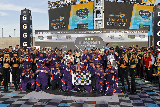 Denny Hamlin and his race team in victory lane after winning the NASCAR Cup Series auto race at ISM Raceway, Sunday, Nov. 10, 2019, in Avondale, Ariz. (AP Photo/Ralph Freso)