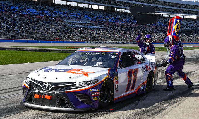 Driver Denny Hamlin's pit crew add fuel on his last pit stop of a NASCAR Cup auto race at Texas Motor Speedway, Sunday, March 31, 2019, in Fort Worth, Texas. Hamlin would win the race. (AP Photo/Larry Papke)