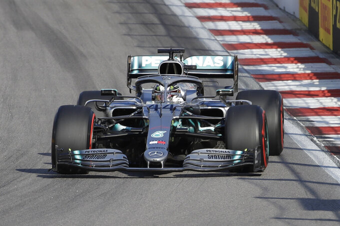 Mercedes driver Lewis Hamilton of Britain, center steers his racer during the qualifying session practice at the 'Sochi Autodrom' Formula One circuit, in Sochi, Russia, Saturday, Sept.28, 2019. The Formula one race will be held on Sunday. (AP Photo/Luca Bruno)