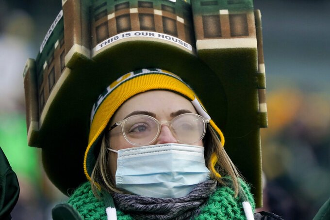 A Packers fan wears a Lambeau Field hat before the NFC championship NFL football game between the Tampa Bay Buccaneers and Green Bay Packers in Green Bay, Wis., Sunday, Jan. 24, 2021. (AP Photo/Morry Gash)