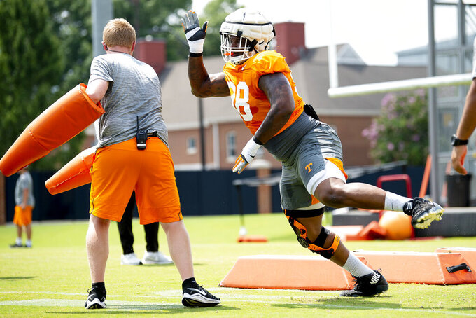In this Aug. 10, 2019, photo, Tennessee defensive lineman Aubrey Solomon (98) runs a drill during the NCAA college football team's practice in Knoxville, Tenn. Solomon has received an NCAA waiver enabling the Michigan transfer to play for the Volunteers immediately rather than sitting out the 2019 season. Solomon's availability provides a giant boost to a Tennessee defensive line that has no returning starters. (Calvin Mattheis/Knoxville News Sentinel via AP)