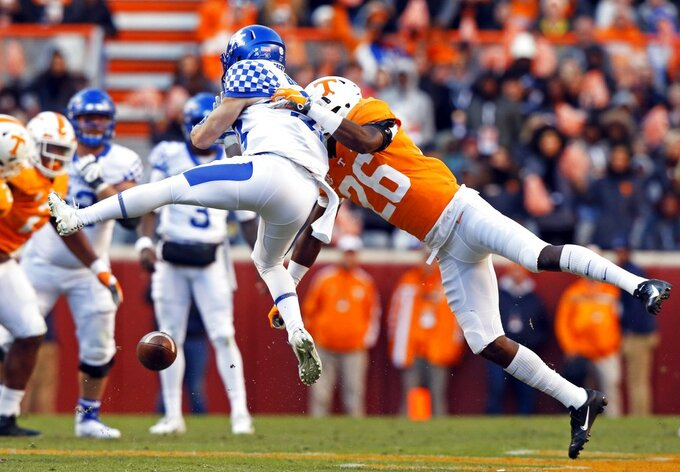 Tennessee defensive back Theo Jackson (26) breaks up a pass intended for Kentucky wide receiver David Bouvier (33) in the first half of an NCAA college football game Saturday, Nov. 10, 2018, in Knoxville, Tenn. (AP Photo/Wade Payne)