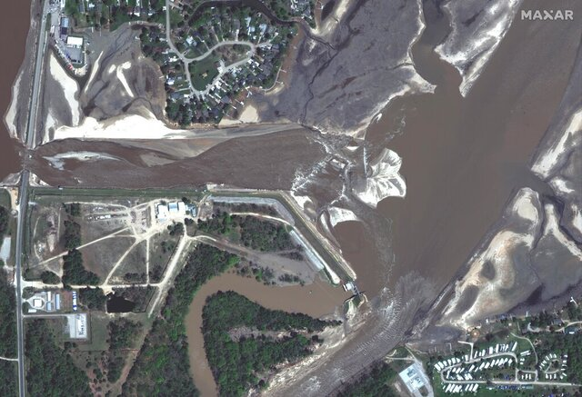 This photo provided by Maxar Technologies shows Edenville Dam in Beaverton, Mich., Thursday, May 21, 2020, after it was damaged. (Maxar Technologies via AP)