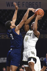 Wake Forest's Jahcobi Neath shoots under pressure from Longwood's Zac Watson during the first half of an NCAA basketball game Friday, Nov. 27, 2020, in Winston-Salem, N.C. (Walt Unks/The Winston-Salem Journal via AP, Pool)