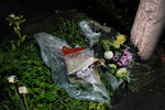 Flowers are placed near the Kyoto Animation building destroyed in an arson attack Thursday, July 18, 2019, in Kyoto, Japan.  The blaze started in the three-story building in Japan's ancient capital after the attacker sprayed an unidentified liquid accelerant, police and fire officials said. (AP Photo/Jae C. Hong)