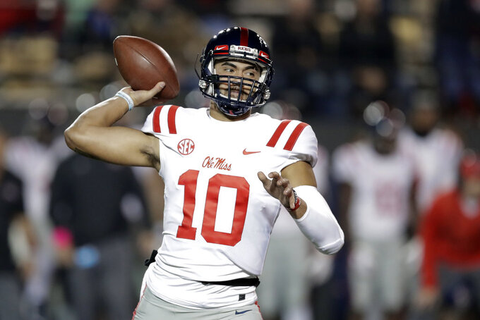 Mississippi quarterback Jordan Ta'amu (10) passes against Vanderbilt in the first half of an NCAA college football game Saturday, Nov. 17, 2018, in Nashville, Tenn. (AP Photo/Mark Humphrey)