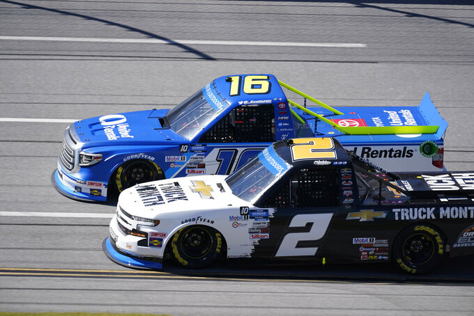 Sheldon Creed (2) and Austin Hill (16) race down the back stretch during the NASCAR Truck series auto race at Talladega Superspeedway, Saturday, Oct. 3, 2020, in Talladega. (AP Photo/John Bazemore)