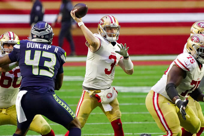 San Francisco 49ers quarterback C.J. Beathard (3) shows against the Seattle Seahawks during the second half of an NFL football game, Sunday, Jan. 3, 2021, in Glendale, Ariz. (AP Photo/Rick Scuteri)