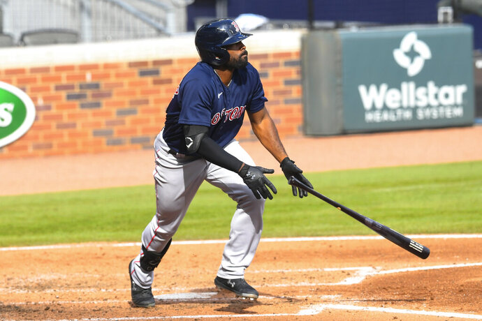 Boston Red Sox' Jackie Bradley Jr. watches his line drive soar to center field for a home run against the Atlanta Braves during the fourth inning of a baseball game Sunday, Sept. 27, 2020, in Atlanta. (AP Photo/John Amis)