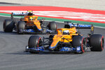Mclaren driver Daniel Ricciardo of Australia leads Mclaren driver Lando Norris of Britain during the Sprint Race qualifying session at the Monza racetrack, in Monza, Italy , Saturday, Sept.11, 2021. The Formula one race will be held on Sunday. (AP Photo/Luca Bruno)