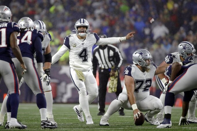 Dallas Cowboys quarterback Dak Prescott calls signals at the line of scrimmage in the first half of an NFL football game against the New England Patriots, Sunday, Nov. 24, 2019, in Foxborough, Mass. (AP Photo/Elise Amendola)