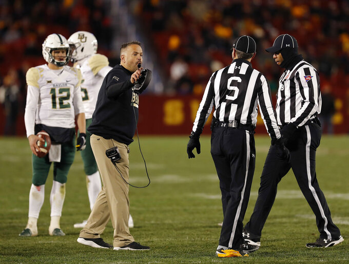 Baylor head coach Matt Rhule, center, disputes a flag during the second half of an NCAA college football game against Iowa State, Saturday, Nov. 10, 2018, in Ames, Iowa. (AP Photo/Matthew Putney)