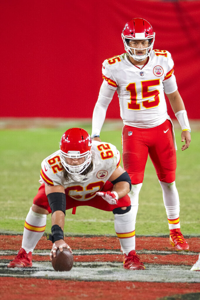 FILE - In this Nov. 29, 2020, file photo, Kansas City Chiefs quarterback Patrick Mahomes (15) prepares to the take the snap from center Austin Reiter (62) as the Chiefs take on the Tampa Bay Buccaneers during an NFL football game in Tampa, Fla. Reiter and Mahomes have built a solid relationship over the last three seasons. (AP Photo/Doug Murray, File)