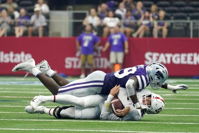 Kansas State defensive end Khalid Duke (29) sacks Stanford quarterback Tanner McKee (18) in the second half of an NCAA college football game in Arlington, Texas, Saturday, Sept. 4, 2021. (AP Photo/Tony Gutierrez)