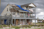 In this photo provided by News21, a home is shown, Sunday, June 2, 2019, where the eye of Hurricane Michael hit Mexico Beach, Fla. Damages have yet to be repaired. (Peter Nicieja/News21 via AP)