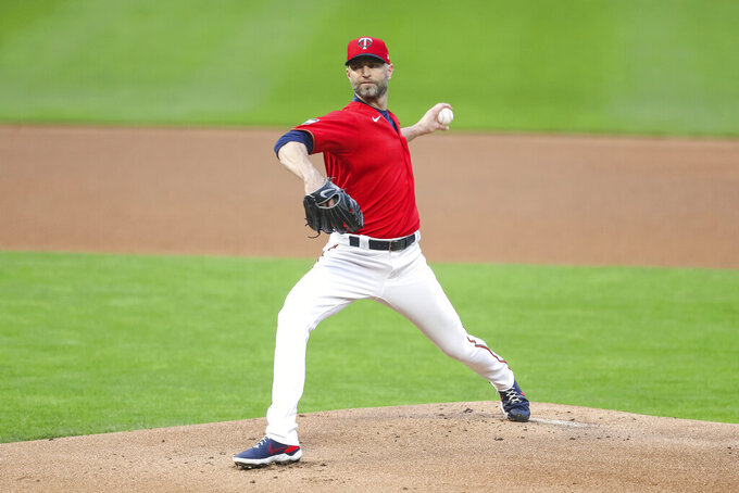 Minnesota Twins starting pitcher J.A. Happ delivers to the Pittsburgh Pirates in the first inning of a baseball game Friday, April 23, 2021, in Minneapolis. (AP Photo/David Berding)