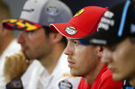 Ferrari's German driver Sebastian Vettel, center, attends during a press conference at the Barcelona Catalunya racetrack in Montmelo, Spain, Thursday, May 9, 2019. The Formula One race will be held on Sunday. (AP Photo/Manu Fernandez)