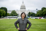 Lisa Sasaki, the director of the Smithsonian Asian Pacific American Center, poses for a photograph in front of the Capitol Building on the National Mall in Washington, Monday, May 13, 2019. On May 18, the Smithsonian Asian Pacific American Center launches a $25 million fundraising drive for permanent gallery space on the National Mall in Washington, D.C. with a glitzy party in Los Angeles full of celebrities and politicians. (AP Photo/Andrew Harnik)