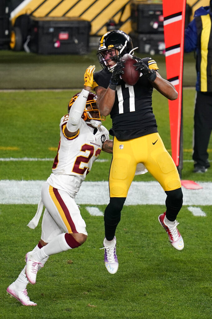Pittsburgh Steelers wide receiver Chase Claypool (11) makes a catch with Washington Football Team cornerback Ronald Darby (23) defending during the first half of an NFL football game, Monday, Dec. 7, 2020, in Pittsburgh. (AP Photo/Keith Srakocic)