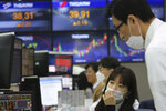 Currency traders watch monitors at the foreign exchange dealing room of the KEB Hana Bank headquarters in Seoul, South Korea, Wednesday, Feb. 26, 2020. Asian shares slid Wednesday following another sharp fall on Wall Street as fears spread that the growing virus outbreak will put the brakes on the global economy.(AP Photo/Ahn Young-joon)