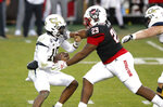 Georgia Tech quarterback Jeff Sims (10) escapes from North Carolina State defensive tackle Alim McNeill (29)  during the first half of an NCAA college football game in Raleigh, N.C., Saturday, Dec. 5, 2020. (Ethan Hyman/The News & Observer via AP, Pool)