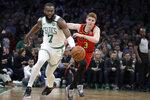 Boston Celtics guard Jaylen Brown (7) brings the ball up next to Atlanta Hawks guard Kevin Huerter (3) during the first quarter of an NBA basketball game Friday, Jan. 3, 2020, in Boston. (AP Photo/Elise Amendola)