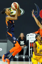 Connecticut Sun forward DeWanna Bonner (24) puts up a shot over Los Angeles Sparks guard Brittney Sykes (15) during the second half of a WNBA playoff basketball game Thursday, Sept. 17, 2020, in Bradenton, Fla. (AP Photo/Chris O'Meara)