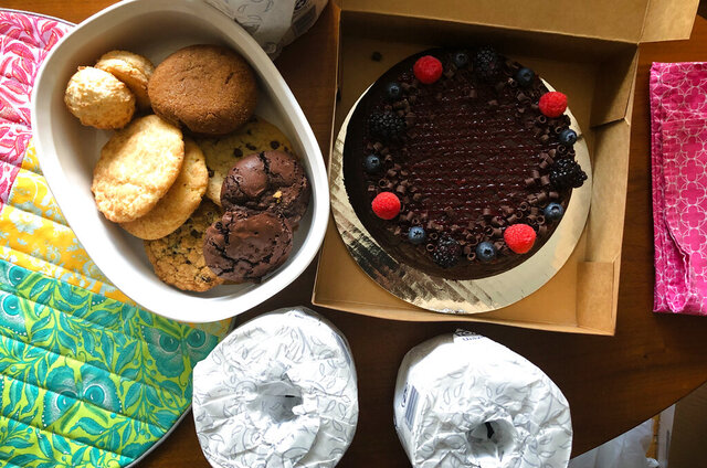 This April 8, 2020, photo shows cookies, a cake and rolls of toilet paper delivered to the writer from her ex-husband in Hopkinton, N.H. This writer has found a surprising source of support over the last few months: Her ex-husband. (AP Photo/Holly Ramer)