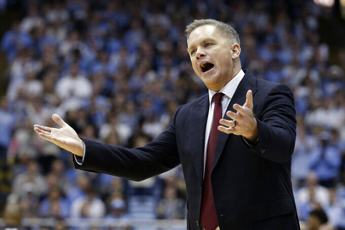 Ohio State head coach Chris Holtmann reacts during the second half of an NCAA college basketball game against North Carolina in Chapel Hill, N.C., Wednesday, Dec. 4, 2019. Ohio State won 74-49. (AP Photo/Gerry Broome)