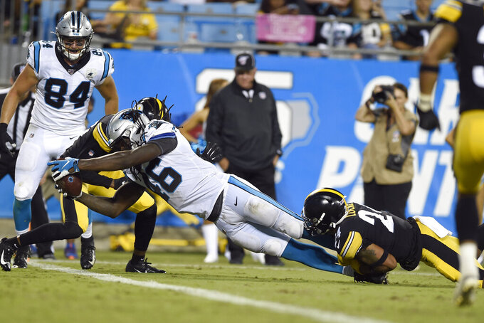 Carolina Panthers tight end Temarrick Hemingway (46) scores while Pittsburgh Steelers defensive back P.J. Locke (24) misses the tackle during the second half of an NFL preseason football game in Charlotte, N.C., Thursday, Aug. 29, 2019. Carolina won 25-19. (AP Photo/Mike McCarn)