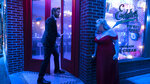 This image released by Warner Bros. Pictures shows Rebel Wilson, right, and Liam Hemsworth in a scene from