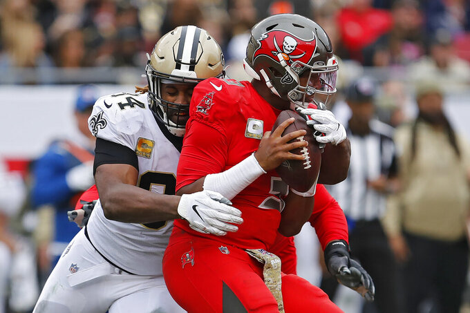New Orleans Saints defensive end Cameron Jordan (94) sacks Tampa Bay Buccaneers quarterback Jameis Winston (3) during the second half of an NFL football game Sunday, Nov. 17, 2019, in Tampa, Fla. (AP Photo/Mark LoMoglio)