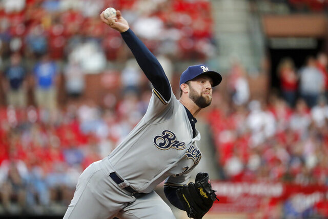 FILE - In this Sept. 14, 2019, file photo, Milwaukee Brewers starting pitcher Jordan Lyles throws during the first inning of a baseball game against the St. Louis Cardinals in St. Louis. The Texas Rangers completed a $16 million, two-year contract with free agent right-hander Lyles, finalizing a deal that had been agreed upon before this week's winter meetings. Texas agreed to a $585,000, one-year contract on Friday, Dec. 13, 2019, with left-hander Jeffrey Springs, designated for assignment by the Rangers 11 days earlier. (AP Photo/Jeff Roberson, File)