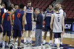 Virginia head coach Tony Bennett, center, talks to his team during practice at the NCAA men's college basketball tournament, Wednesday, March 27, 2019, in Louisville, Ky. (AP Photo/Michael Conroy)