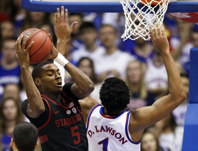 Stanford forward Kodye Pugh (5) rebounds against Kansas forward Dedric Lawson (1) during the first half of an NCAA college basketball game in Lawrence, Kan., Saturday, Dec. 1, 2018. (AP Photo/Orlin Wagner)