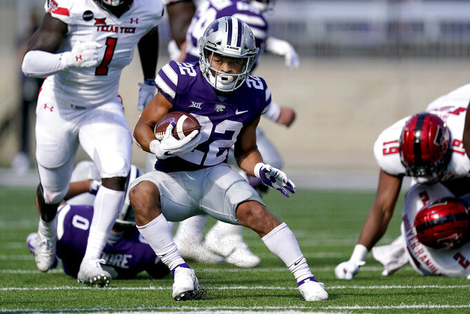 Kansas State running back Deuce Vaughn (22) runs for a first down during the first half of an NCAA college football game against Texas Tech Saturday, Oct. 3, 2020, in Manhattan, Kan. (AP Photo/Charlie Riedel)