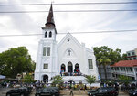 FILE - In this June 25, 2015, file photo, people line up to attend the wake of Sen. Clementa Pinckney, one of the nine killed in a shooting, at Emanuel AME Church in Charleston, S.C. (AP Photo/David Goldman, File)