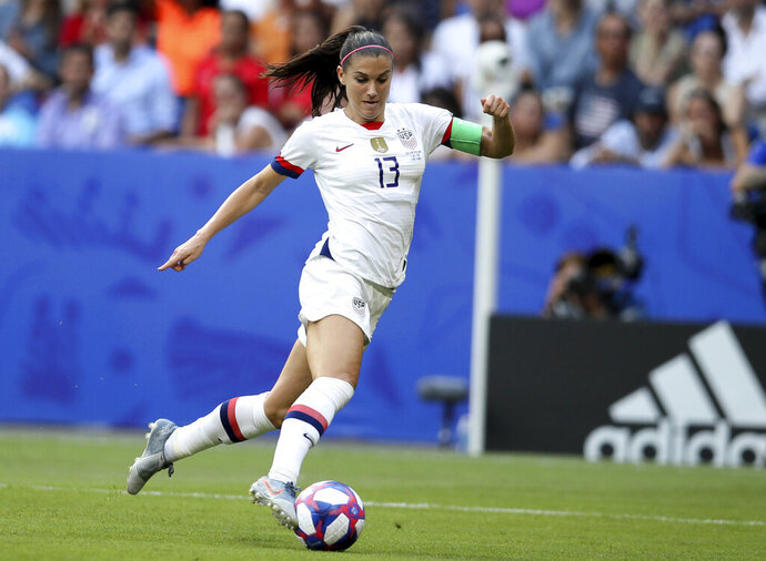 FILE - In this July 7, 2019, file photo, United States' Alex Morgan controls the ball during the Women's World Cup final soccer match against The Netherlands at the Stade de Lyon in Decines, outside Lyon, France. Tottenham secured the biggest signing yet in a summer of high-profile acquisitions in the Women's Super League by bringing in United States striker Alex Morgan on a one-season deal. The 31-year-old Morgan will play in England for the first time and moves four months after giving birth to her first child. (AP Photo/David Vincent, File)
