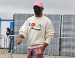 Mercedes driver Lewis Hamilton of Britain arrives at the paddocks for preparations before the 70th Anniversary Formula One Grand Prix at the Silverstone circuit, Silverstone, England, Thursday, Aug. 6, 2020.(AP Photo/Frank Augstein)