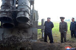 In this Tuesday, Sept. 10, 2019, photo provided by the North Korean government, North Korean leader Kim Jong Un visits a multiple rocket launcher site at an undisclosed location in North Korea. The content of this image is as provided and cannot be independently verified. Korean language watermark on image as provided by source reads:
